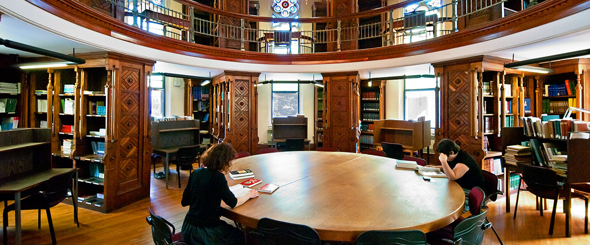 Students sitting at a round table read in the Octagon Room of the Islamic Studies Library at McGill University