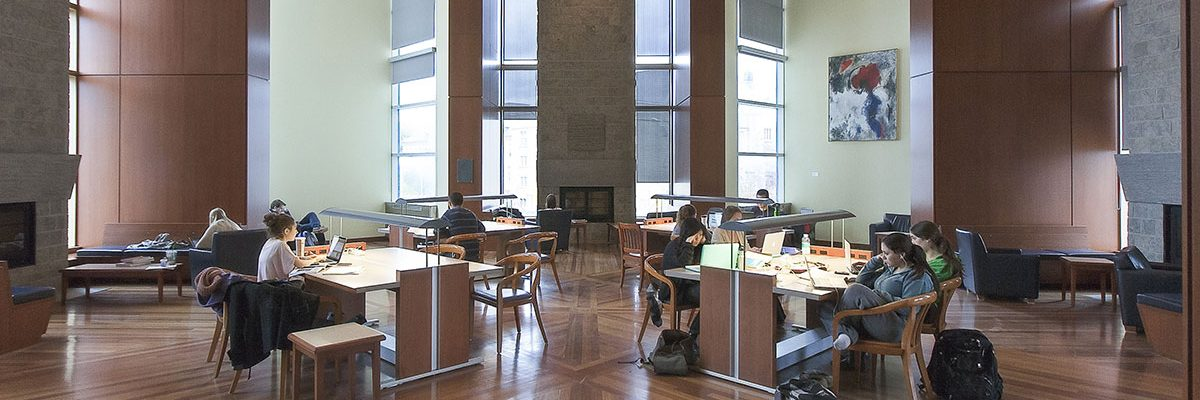Students study in the Alan G. Green Fireplace Reading Room of the Stauffer Library at Queen's University