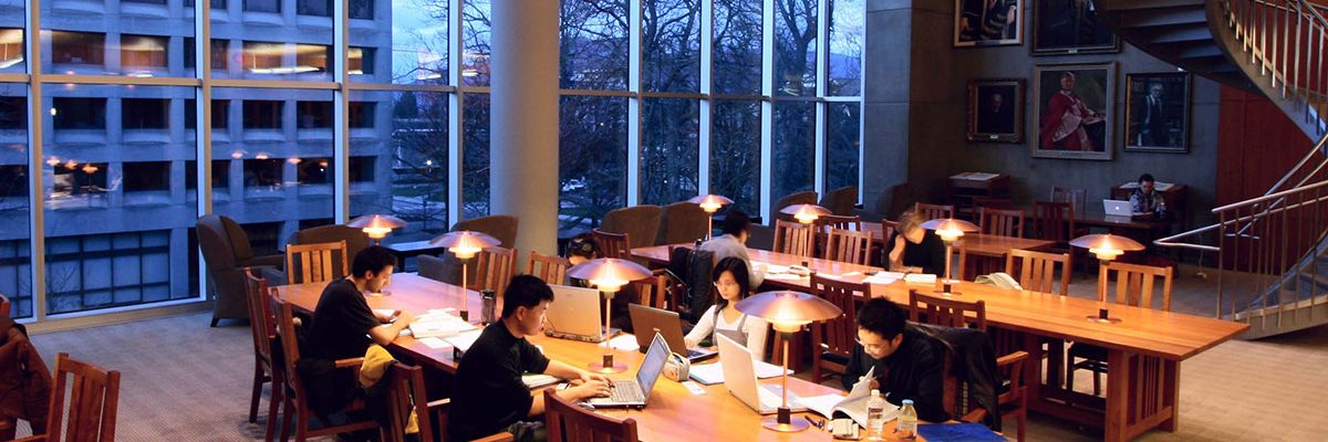 Students studying in the early evening in the Ridington Room of the Irving K. Barber Learning Centre at the University of British Columbia